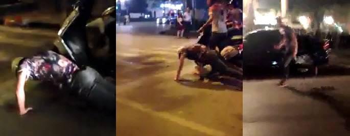 Thanh niên bị tên cướp nhảy lên xe và chạy mất vì hít đất nơi đèn đỏ.